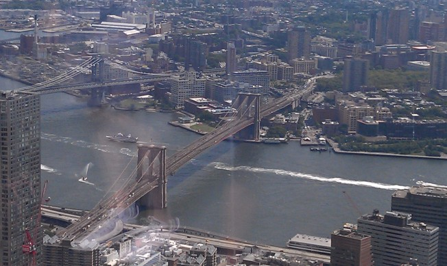 Looking east, this is the historic Brooklyn Bridge connecting the boroughs of Manhattan and Brooklyn.