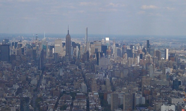 Looking North, a very long view of Manhattan. The Empire State Building is in the middle left of this picture.