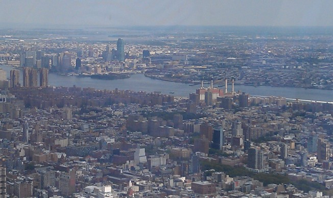 Looking northeast, top to bottom is Queens, the East River, and the Lower West Side of Manhattan.